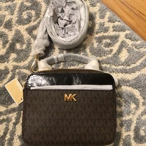 92aa79c2d6b5 Michael Kors Bags - MICHAEL KORS Mott Mini Logo Leather Crossbody